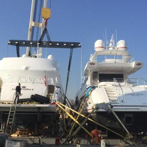 United Yacht Transport loading 130' Mangusta and 95' Princess yachts in Genoa, Italy